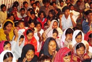 Pakistan.MC.churchmeeting.praying.people